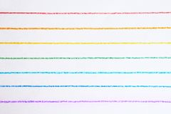 Rainbow colored horizontal lines drawn with colored pencils. stock images