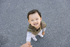 I Trust You. Cute smiling little boy holding someones hand signifying trust Royalty Free Stock Photography