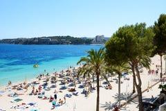 I turisti che enjoiying la loro vacanza sulla spiaggia Immagine Stock Libera da Diritti