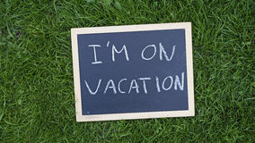 I am on vacation written Stock Image