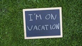 I am on vacation written Stock Image