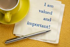 I am valued and important. Handwriitng on a napkin with a cup of coffee royalty free stock photos