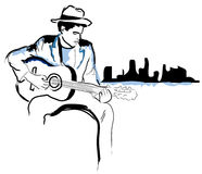 I've Got the Blues. A stylized illustration of a talented young man playing blues guitar in front of a big city Stock Photography