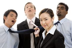 I've Got My Dream Team. A cute asian businesswoman has three handsome guys by their ties royalty free stock images