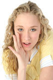 I've Gotta Secret. Beautiful young woman whispering secrets toward camera Royalty Free Stock Photos