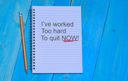 I`ve worked too hard, To quit now text on notebook Stock Image