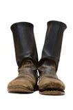 I vecchi stivali dei soldati. Immagini Stock