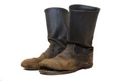 I vecchi stivali dei soldati. Immagine Stock