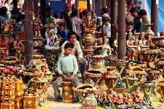 I venditori fatti senza aver l'età al Surajkund perfezionamento Mela Fotografie Stock