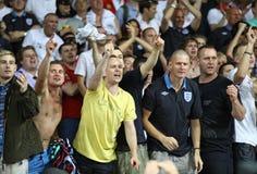 I ventilatori inglesi reagiscono dopo che battimento dell'Inghilterra della Svezia Immagini Stock