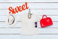 I vestiti e gli accessori delle donne Immagine Stock