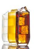 I vetri con la soda arancio e la limonata della cola ghiacciano Fotografie Stock Libere da Diritti