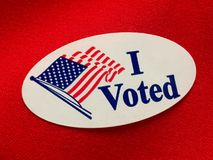 I voted. Sticker on red fabric Stock Photo