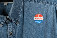 Blue denim working clothing with I Voted sticker stock photography