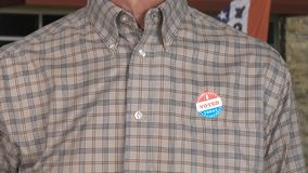 Senior caucasian man in casual clothing with Voted sticker stock photos