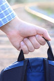 I wait for new travel!. The backpack in a hand Royalty Free Stock Photo
