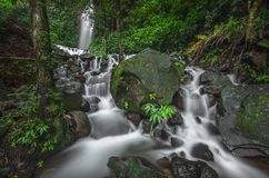 Dreamy Waterfall in The Tropical Forest Stock Image