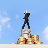 I want be rich. Happy business man using megaphone shouting on money stairs with blue sky background, asian stock image
