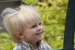 I want more fun please. Small boy with a smiling face outdoor Stock Photography