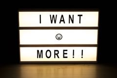 I want more light box sign board. On wooden table Royalty Free Stock Images