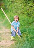 I want to find treasures. Little boy with shovel looking for treasures. Happy childhood. Adventure hunting for treasures royalty free stock image