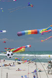 I want to Fly. Multi colored kites on breezy beach day Royalty Free Stock Image