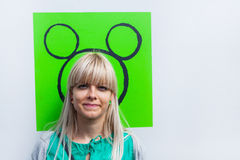I want to have such ears. Young woman with drawn ears on the wall Stock Photo