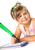 I want to know all. Blue-eyed little girl with big green pen isolated on white Royalty Free Stock Images