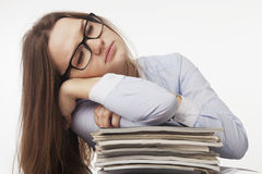 I want to sleep. Young business woman tired from office work wit Royalty Free Stock Images