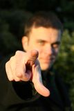 I want YOU!. A man points at the camera, focus on hand Royalty Free Stock Photography