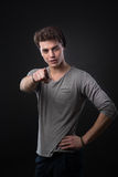 I want you. Handsome confident young man pointing at camera on dark background Royalty Free Stock Images