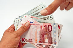 I want your money. Hands and euro money on white Stock Photos