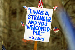 I was a stranger and you welco. Political—and religious—sign at a pro-immigration rally in USA Stock Image
