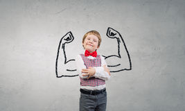I will be strong as father. Portrait of adorable little boy with arms crossed on chest Royalty Free Stock Photo