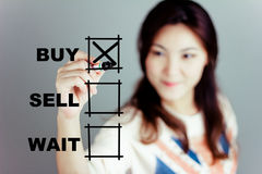 I will buy it. Asia girl design to buy a stuff Stock Photo