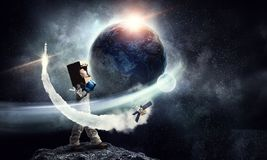 I will explore space . Mixed media. Kid girl with carton box on head playing astronaut. Mixed media. Elements of this image are furnished by NASA Royalty Free Stock Photography