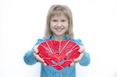 I will give you my heart. A young woman is holding a heart in her arms Royalty Free Stock Photography