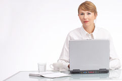I will handle it. Businesswoman sitting behind her laptop stock photography