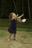I will push you God. This little girl gives the swing a little push Stock Images