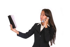 I will read it for you. Woman doing businesses by telephone, reading her note book Royalty Free Stock Photos