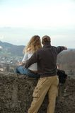 I will show you the world. A man shows the woman landscape on fort's wall Stock Photo