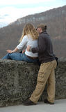 I will show you the world. A man shows the woman landscape on old wall stock photography