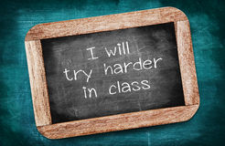 I will try harder in class written on a blackboard / intention c Royalty Free Stock Images