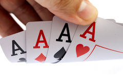 I win. Four aces, on white background. I win. Holding four aces, close up, on white background Royalty Free Stock Photography