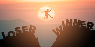 I am winner not loser. Silhouette man jumps get away from LOSE to the WIN. Stock Photo