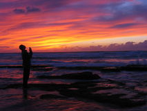 I wish. Man looking on sunset skys Stock Images