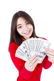 I Wish I Have More Money. Slim sweet looking girl wishing more money with money in her hands. In red catchy sweter, isolated on white background Stock Images