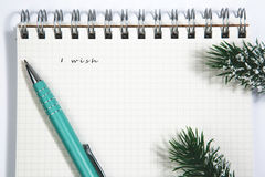 Wish list, Notebook and yellow pen Stock Image