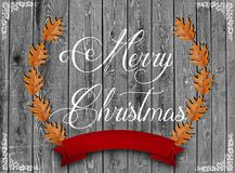 I Wish You A Merry Christmas wrote and brown leaves Stock Photo