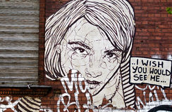 I wish you would see me street art in Berlin. I wish you would see me, large woman street art with window in Berlin/Germany royalty free stock images